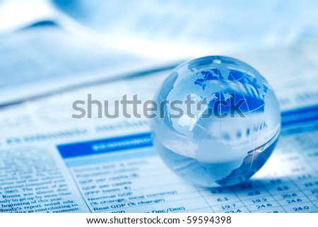 Globe on financial report - stock photo