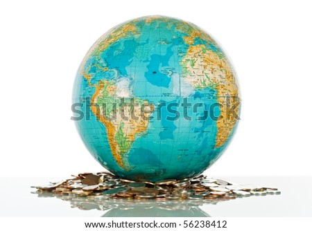 Globe on the pile of coins - isolated - stock photo