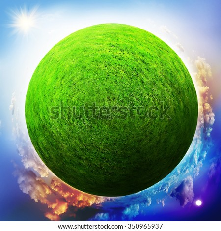 Globe with grass with the change of day and night - stock photo