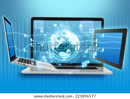 Globe with icons surrounded by laptops and tablets - stock photo