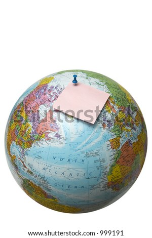 Globe with pinned paper note - stock photo
