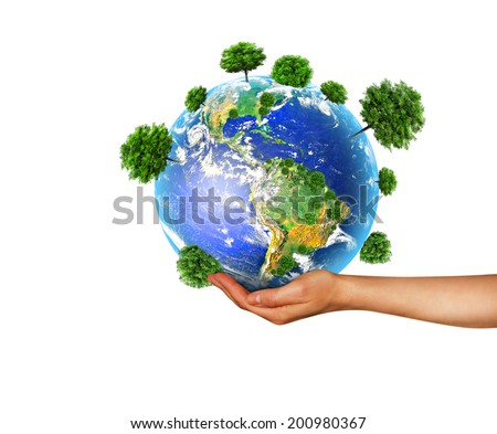 Globe with trees in hand. South and North America. Elements of this image furnished by NASA - stock photo