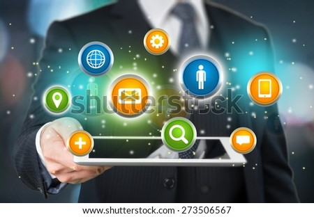Globe. Young businessman presenting 3d earth globe in tablet elements of this image furnished by NASA - stock photo