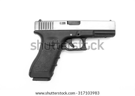Glock pistol handgun with a white background - stock photo