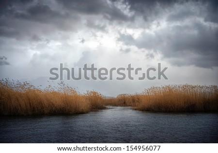 Gloomy autumn sky over Prespa lake, Florina, Greece - stock photo