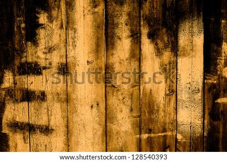 Gloomy background of old cracked wooden fence - stock photo