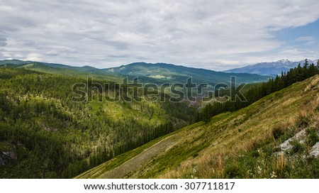 gloomy sky over the mountain valley of Altai - stock photo