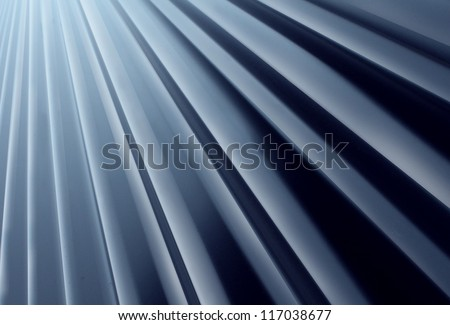 Glossy Metal Radial background made of painted curved aluminum sheet steel looking up as a construction design element for modern architecture and new age outdoor building material. - stock photo