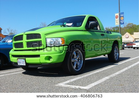 GLOUCESTER, VA - April 16, 2016: A lime green Dodge Hemi GTX pickup truck at the Daffodil car show, the Daffodil car show is held once each year after the Daffodil parade and festival.   - stock photo