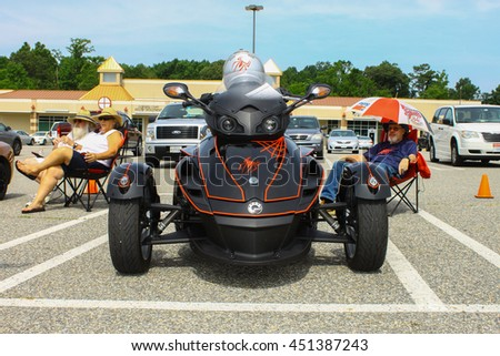 GLOUCESTER, VA - JULY 9, 2016: A Black Can Am reversed three wheeled motorcycle at the Collector Car Appreciation Day Car Show sponsored by the Middle Peninsula Classic Cruisers car club. - stock photo