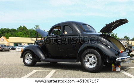 GLOUCESTER, VA - JULY 9, 2016: A black two door Ford Coupe at the Collector Car Appreciation Day Car Show sponsored by the Middle Peninsula Classic Cruisers car club.  - stock photo