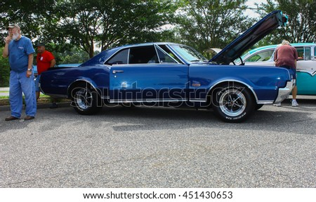 GLOUCESTER, VA - JULY 9, 2016: A Blue Oldsmobile Cutlass 442 at the Collector Car Appreciation Day Car Show sponsored by the Middle Peninsula Classic Cruisers car club. - stock photo