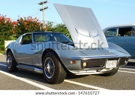 GLOUCESTER, VA- JULY 26: A 1969 Corvette Stingray in the 17th Annual 2013 MPCC(middle peninsula car club)meeting at the Main St shopping center in Gloucester, Virginia on July 26, 2013 - stock photo