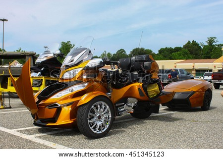GLOUCESTER, VA - JULY 9, 2016: A gold Can Am Spyder reversed three wheeled motorcycle at the Collector Car Appreciation Day Car Show sponsored by the Middle Peninsula Classic Cruisers car club. - stock photo