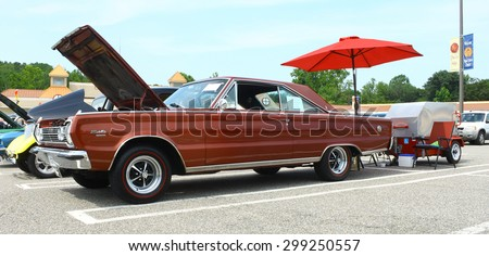 GLOUCESTER, VA- JULY 19: A 1966 Plymouth Satelite and trailer at the 2015 Middle Peninsula Classic Car Club blast from the past car show in Gloucester Virginia - stock photo
