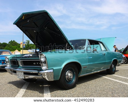 GLOUCESTER, VA - JULY 9, 2016: A Teal blue 1965 Pontiac GTO with a six pack engine at the Collector Car Appreciation Day Car Show sponsored by the Middle Peninsula Classic Cruisers car club.  - stock photo