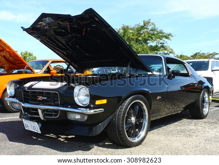 GLOUCESTER, VIRGINIA - AUGUST 22, 2015:A 1973 Chevrolet Camaro in the DRIVE-IN FOR DIABETES CAR SHOW Sponsored by Tractor Supply in August in Gloucester Virginia. - stock photo