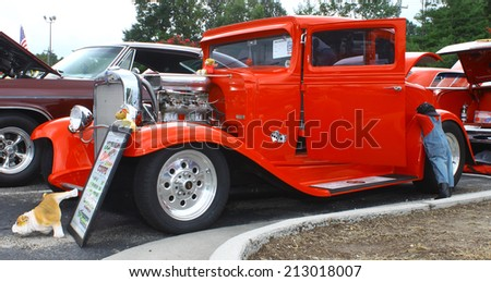 GLOUCESTER, VIRGINIA - AUGUST 23, 2014:A 1931 Chevy 5 window coupe in the DRIVE-IN FOR DIABETES CAR SHOW Sponsored by Tractor Supply in August in Gloucester Virginia. - stock photo