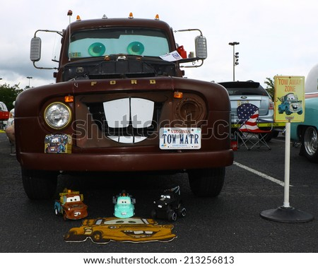 GLOUCESTER, VIRGINIA - AUGUST 23, 2014:A Ford Tow Mater tow truck like the one from Cars the movie in the DRIVE-IN FOR DIABETES CAR SHOW Sponsored by Tractor Supply in August in Gloucester Virginia. - stock photo
