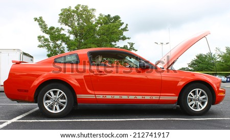 GLOUCESTER, VIRGINIA - AUGUST 23, 2014:A red Ford Mustang in the DRIVE-IN FOR  DIABETES CAR SHOW Sponsored by Tractor Supply in August in Gloucester Virginia. - stock photo