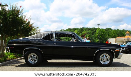 GLOUCESTER, VIRGINIA - JULY 12, 2014: A Black Chevrolet Nova in the Blast from the PAST CAR SHOW,The Blast From the Past car show is held once each year in July in Gloucester Virginia.  - stock photo