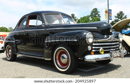 GLOUCESTER, VIRGINIA - JULY 12, 2014: A Black 1948 Ford coupe in the Blast from the PAST CAR SHOW,The Blast From the Past car show is held once each year in July in Gloucester Virginia.  - stock photo