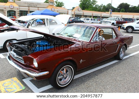 GLOUCESTER, VIRGINIA - JULY 12, 2014:A Burgundy 1965 Ford Mustang in the Blast from the PAST CAR SHOW,The Blast From the Past car show is held once each year in July in Gloucester Virginia. - stock photo