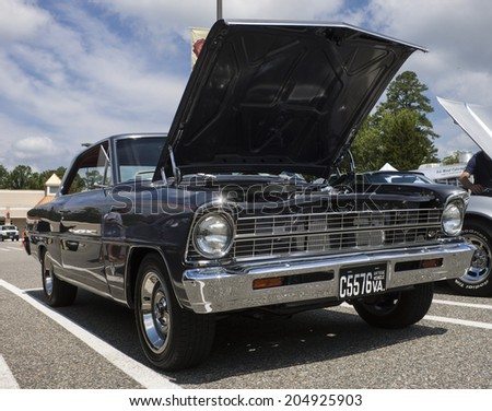 GLOUCESTER, VIRGINIA - JULY 12, 2014: A Grey/black Chevrolet Nova square body in the Blast from the PAST CAR SHOW,The Blast From the Past car show is held once each year in July in Gloucester Virginia - stock photo