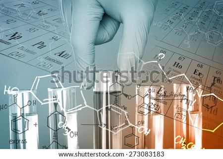 Gloved hand holding the test tubes at laboratory, with chemical equations and periodic table background. - stock photo