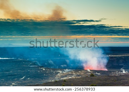 Glow of an erupting volcano at early sunrise at Hawaii Volcanoes National Park, Big Island, Hawaii - stock photo