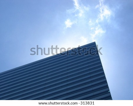 Glow on Top of Building on a clear blue sky - stock photo