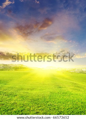 Glow sun on green meadow. Bright colour on sky - stock photo
