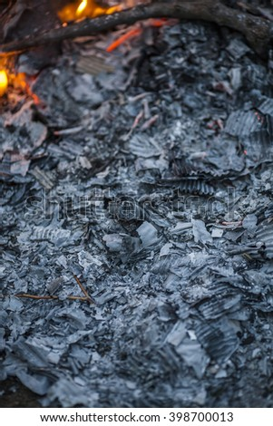 Glowing ashes in a dying fire - stock photo