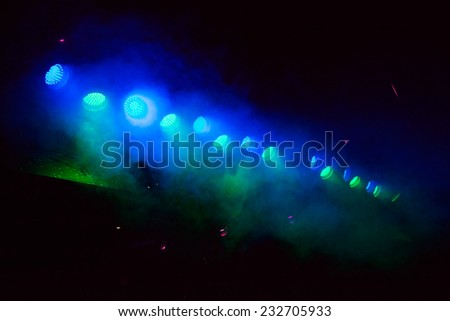glowing blue and green spotlights. background - stock photo