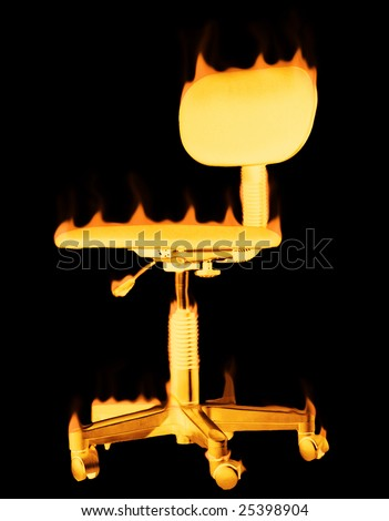 Glowing burning chair that has flames on it - stock photo