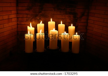Glowing Candles in a Fireplace - stock photo