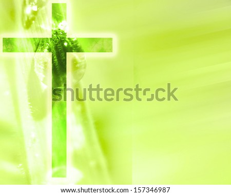 glowing christian cross on a green nature background - stock photo