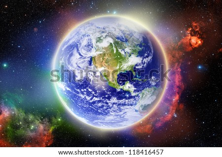 Glowing Earth surrounded by nebula - Elements furnished by NASA - stock photo