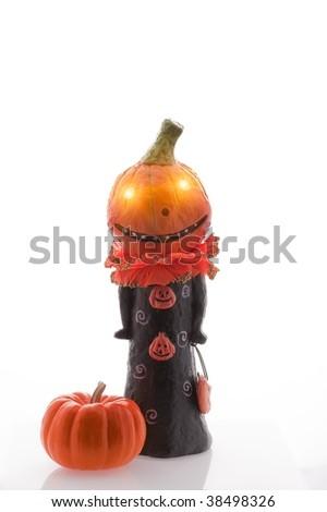 Glowing eyes Jack O'Lantern and pumpkin - stock photo