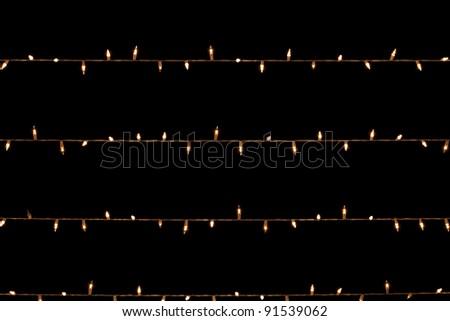 Glowing garland on black sky  background - stock photo