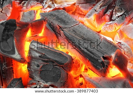 Glowing Hot Charcoal In BBQ Grill Pit With Flames Background Texture, Close-up - stock photo