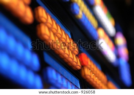 Glowing keys on a media console in a dark room - stock photo
