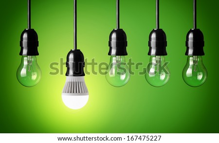 Glowing LED bulb and simple light bulbs  - stock photo