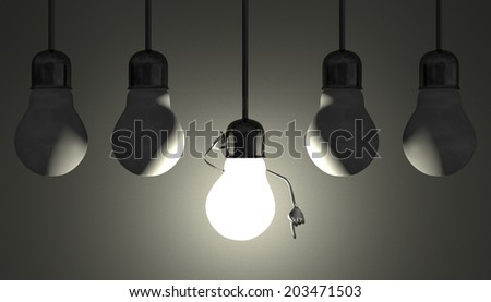Glowing light bulb character in lamp socket on wire in moment of insight among many switched off light bulbs on gray textured background - stock photo