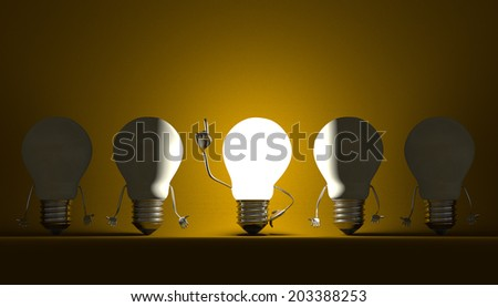 Glowing light bulb character in moment of insight among switched off ones on yellow textured background - stock photo