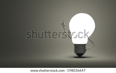 Glowing light bulb character in moment of insight on dark gray textured background - stock photo