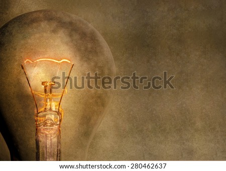 Glowing light bulb. Space for text. - stock photo