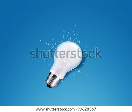 glowing Light bulb with water splash on Blue background - stock photo