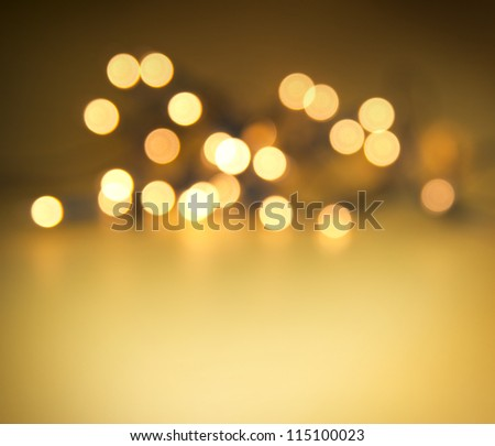 glowing lights on golden background - stock photo