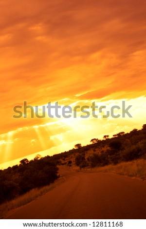 Glowing orange African sunset - stock photo